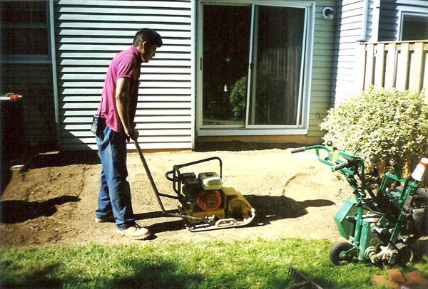 Compacting soil